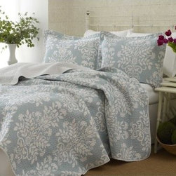 Laura Ashley Rowland Reversible Quilt Set - The Laura Ashley Rowland Reversible Quilt Set helps breathe new life into any design, providing a subtle accent to your bedroom decor. Included in this set are two pillow shams (one sham with twin size) and a quilt, each featuring a beautiful white floral pattern on your choice of background, either sage green or breeze blue. Each piece is made from plush 100% cotton; the quilt features a soft cotton fill and a solid white reversible pattern. Twin, full/queen, and king sizes are all available (see below for dimensions).Quilt Dimensions:Twin: 88L x 68W inchesFull/Queen: 90L x 90W inchesKing: 96L x 104W inchesAbout Laura AshleyFounded in Great Britain, Laura Ashley is known for its historic and coveted British fabrics, wallpapers, and cushions. It has recently expanded to North America to offer a full range of global products for the home and garden.