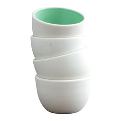Pigeon Toe Ceramics - Stacking Thimble Cups, Set of 4, Mint - A set of 4 stacking porcelain cups ready to hold sauces, spices or a single airplant. Unglazed sanded exterior, interior color of your choice (shown in Mint). Comes stacked in an unbleached muslin bag.
