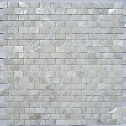 "White Mother of Pearl Minibrick 5/8"" x 1"" Tile - Mother of pearl tiles add new and unique elegance to your bathroom, backsplash, headboard, and more. Our Mother of Pearl tiles are handmade from genuine natural freshwater pearls. Although Mother of Pearl tiles are naturally thin, they are very strong and durable as well as easy to install in kitchens, bathrooms, and pools."