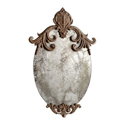 Charlemagne Mirror - An iron fleur-de-lis surrounded by scrolls rests at the peak of the Charlemagne Mirror, a perfect wall piece for giving a delicate, aristocratic air to its surroundings while conveying age and history with its heavy patina and rusted metals. This oval wall mirror offers a sublime detail for an antique bath, a romantic bedroom retreat, or a deeply-detailed living room.