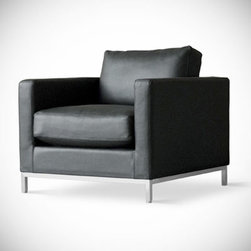 Gus* - Trudeau Chair - Trudeau Chair  by Gus Modern    At A Glance:   The comfortably cushioned Trudeau Chair is a fantastic addition to your den or sitting room. The extra-thick seat cushion - filled with down feathers - means you'll enjoy a relaxing lounging experience every time you take a load off.  What's To Like:  This Gus lounge chair is a departure from their norm (foam-cushioned chairs that are a bit on the firm side). The Trudeau Chair is legitimately comfortable.Not only is it comfortable, it looks good. We're talking seriously great looks here, folks - the proportions and material choices Gus Modern has assigned to the Trudeau Chair are as close to perfect as it gets.  What's Not to Like:   Goldilocks, if you're out there, this lounge chair is too comfortable for you. Go find Baby Bear's chair.  The Bottom Line:   The Trudeau Chair from Gus Modern, with its classically proportioned look and comfortable feather cu