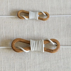 Wrapqarw Cord Wrap - Tangled cords will (thankfully) be a thing of the past with these Japanese cord wraps.