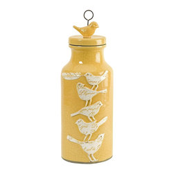 Imax - iMax Adelaide Small Script Birdy Jar whit Lid X-96181 - Towering bird silhouettes feature embossed script typography elements over a small yellow bodied lidded jar.