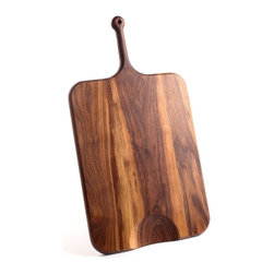 De JONG & Co. - Serving Board No.3 - Hand-shaped black walnut. Leather hanging loop. Hand-carved cutout. Food safe. Fully seasoned with walnut oil and wax finish. Products are made to order which can result in longer lead times.