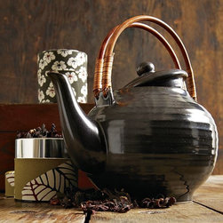 New Ceramic Teapot - Make it a tea time ritual. Bringing Far Eastern style to the table, this gray ceramic teapot has subtle ridged details that recreate the look and feeling of traditional hand-thrown pottery. The handle covered in rattan protects hands from heat.