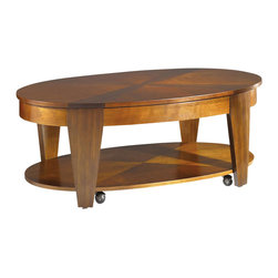 Hammary - Oasis Oval Cocktail Table w Casters - Lift-top. Lower storage shelf. Soft rounded lines and extra-wide legs. Lightly burnished and hand-rubbed finish. Limited warranty. Made from cherry and walnut veneers. Rich medium cherry and walnut finish. Assembly required. 50 in. W x 30 in. D x 19 in. HOasis collection breaks the mold of traditional, bland designs and makes any home a haven of elegance and panache. These transitional tables were created with today's casual interiors in mind: lavish enough to impress, but practical enough for everyday living.