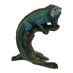 Blue/Green Iguana on Branch Statue 7.5 In. - This realistic iguana sits perched on a gnarled branch for passersby to admire. Its beautiful blue and green coloring is sure to be noticed, and it shows great detail from the bark on the branch to the scales on the skin. Made of cold cast resin, this piece measures 7 1/2 inches tall, 7 inches long, and 3 inches wide. It makes a lovely accent piece anywhere in your home, and is sure to start a conversation.