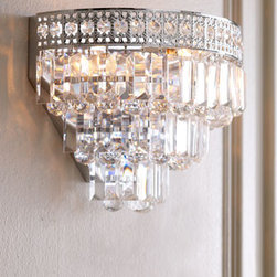"Crystal Wall Sconce - Breathtaking, this crystal wall sconce is over-the-top stunning.  Light dances through the crystals to illuminate your hall, stairway, entry or wherever you use this beautiful sconce.    * Made of lead-free crystal.    * 14""W x 10""T."