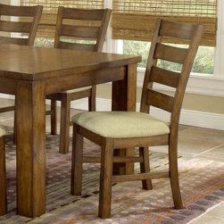 Hillsdale Hemstead Wood Dining Chair - Set of 2 - Dark Oak - The unpretentious design and classic appeal of this Set of 2 Dark Oak Hemstead Wood Dining Chairs makes them perfect for a traditional farmhouse or lodge-style dining area. Each chair is handsomely and sturdily crafted with quality hardwoods and features a comfortable fabric seat. Each chair also features clean lines and a rustic feel and a ladder back for added visual interest. Finally a dark oak finish adds to the natural and traditional appeal of the chairs. Measures 19L x 23W x 39.5H inches. About Hillsdale FurnitureLocated in Louisville Ky. Hillsdale Furniture is a leader in top-quality affordable bedroom furniture. Since 1994 Hillsdale has combined the talents of nationally recognized designers and globally accredited factories to bring you furniture styling and design from around the globe. Hillsdale combines the best in finishes materials and designs to bring both beauty and value with every piece. The combination of top-quality metal wood stone and leather has given Hillsdale the reputation for leading-edge styling and concepts.