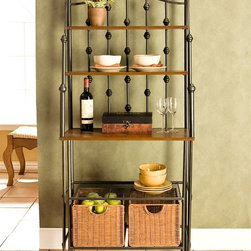 "Holly & Martin - Carlsbad Baker's Rack - The baluster style back of this black metal framed bakers rack is echoed in the finials capping the decoratively curving sides of this piece. Three top shelves feature a rich wood stained finish. Below a grill style metal shelf is followed by a row with two large brown rattan baskets. * Cabinet bakers rack. Made of round metal tube, rattan baskets and MDF shelves with veneer. 5 Shelves. Powder coated black finish with MDF shelf. Included: 2 large rattan storage baskets       . Not included: wine bottle, plates, plants. 30"" W x 17.25"" D x 67.25"" Tall                                                                      . Top shelf - 23"" wide x 6.5"" deep (5 lb. weight limit). 2nd shelf - 23"" wide x 10"" deep x 9"" tall (10 lb. weight limit).  Counter - 23"" wide x 15"" deep x 12.5"" tall . Wire shelf - 23"" wide x 15"" deep x 11"" tall (25 lb. weight limit). Elegant and beautiful, this unique black frame baker's rack is a blend of form and function. Combining multiple shelves of varying sizes, a large tabletop workspace, and two spacious rattan storage baskets this kitchen organizer is sure to suit your needs. The decorative black frame is crafted from metal tubing to ensure strength and durability."