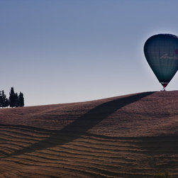 Early Morning Balloon Ride in the Tuscan Hills by Juergen Berkessel - Hot air balloon touching down on a tranquil landscape. About $650 for a 32 x 24 inch piece. Available in other sizes. Visit http://www.printedart.com for more info.