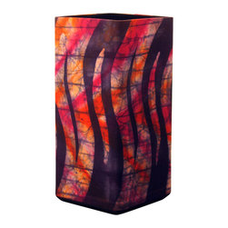 """funyhed BATIK - Batik Lamp """"Ribbon Candy"""" - This unique designer batik lamp is made of my one of a kind handmade batik fabric. The bold orange and fuchsia set against a background of dark navy and indigo create a stunning effect that will add character to any room. The diffused light shines beautifully through the batik fabric emphasizing every line and wax crackle."""