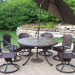 Oakland Living - Tuscany Stone Art 9-Pc Round Patio Dining Set - Includes table, six swivel chairs, tilting umbrella and stand. Fade, chip and crack resistant. Solid and sturdy yet trendy designs. Brass hardware. Warranty: One year limited. Made from natural stone, tubular iron with all weather resin wicker. Hardened powder coat finish in black. Minimal assembly required. Table: 54 in. Dia. x 29 in. H. Umbrella: 108 in. L x 108 in. W x 100 in. H (45 lbs.)Our stone art dining sets will be a beautiful addition to your patio, balcony or outdoor entertainment area. Stone art dining sets are perfect for any small space or to accent a larger space. The Oakland Stone Art Collection combines natural stone and modern designs giving you a rich addition to any outdoor setting.