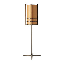 Wright Table Lamp - Named after the innovative American architect, our Wright Table Lamp combines mid-century elegance with decorative functionality. A parchment shade is surrounded by complementary warm metal that rises from a simple base.
