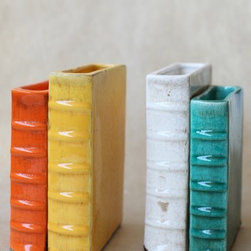 Literary Adventure Bookends - I think these enamel book holders will fit right into a bookshelf. Cover your books in white paper so that they really stand out.