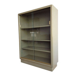 Pre-owned Mid-Century Bookshelf Display Case by All-Steel - Display your objects of curiosity in this great looking industrial cabinet by All-Steel. The fully painted steel unit features three adjustable shelves that are closed off by two sliding glass doors with brass finger pulls.    Condition: Cabinet is in great vintage condition with only a few minor scuffs and scratches. The unit has been cleaned and polished inside and out.