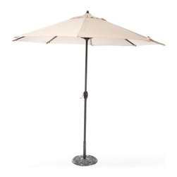 Coral Coast 9 ft. Olefin Auto Tilt Aluminum Patio Umbrella - Try as you might, you simply won't find a more affordable auto tilt patio umbrella with a durable Olefin fabric shade than the Coral Coast 9 ft. Auto Tilt Aluminum Patio Umbrella. It's all in the engineering. This unique umbrella raises the tilt joint position on the frame (tilt mechanism). This unique design distributes weight away from the joint, resulting in a far lower chance of breakage compared to other auto-tilt products. This allows the tilt joint to be made from a lighter weight material instead of costly metal. The auto-tilt feature conveniently allows you to adjust the pitch of the umbrella shade to block the sun. Simply use the crank to open the umbrella, then continue turning until you get to the desired shade pitch. To enjoy the auto tilt feature, simply crank the umbrella until the canopy is fully opened, then continue to crank until the umbrella shade reaches the desired tilted position. The solution-dyed Olefin shade is a hardwearing fabric that will last several seasons and you have several colors to choose from. Each one will look handsome paired with the textured aluminum pole in a bronze finish.