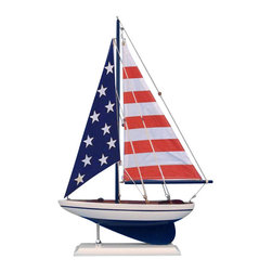 Handcrafted Nautical Decor - USA Flag Sailer 17'' - NOT A MODEL SHIP KIT   --Attach Sails and this Sailboat Centerpiece is Ready for Immediate Display ---- --Brighten  your day, or any room of your home, with   this delightfully fun  Pacific Sailboat model. Perfect nautical Decor gifts for friends,    children, or party guests, they also make excellent nautical decorations  or sailboat centerpieces for a reception or group event. Liven your  office, beach   house, or sunroom with one of these colorful sailboat  models today! --------    Handcrafted solid wood hull, masts and stand with metal supports--    Timeless nautical colors - Navy blue and white--    Largest sailboat selection available - We offer over 150 unique model sailboats --    Featured in Sept 2011 Brides magazine - Excellent wedding table centerpiece--    --    Perfect nautical gift for friends, children or party guests--    --    Ideal for banquets, receptions, meetings, or any other nautical party or event ---- Contact us for quantity discounts---- --This model sailboat requires minor assembly. Simply insert mast into hull and clip on the sails. --There is no rigging to tie or tighten. Assembly takes less than 2 minutes.