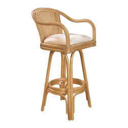 Hospitality Rattan - Hospitality Rattan Key West Rattan & Wicker Natural Swivel Bar Height Stool - Bring the tropics to your home with the Key West Counter stool. It is a traditional wicker and rattan swivel counter stool that is built with solid rattan pole construction reinforced with a pencil rattan twist. The Key West Collection offers three basic finishes Antique Natural and Whitewash. The counter stools feature commercial grade reinforced rattan bases swivel mechanisms & reinforced double pole footrests. The stool will come with instructions and requires assembly. It comes with a comfortable cushion in the beige fabric as shown. For an upcharge you can choose from your choice of over 35 fabrics in a variety of colors and patterns to match your decor. The Key West counter stool is the perfect addition to your bar. Since 2000 Hospitality Rattan has been designing and distributing contract quality rattan wicker and bamboo furnishings. A variety of indoor and outdoor collections derived from the best possible materials is available for the furniture buyer who wants that tropical feel. Features include Includes cushion with fabric as shown Swivel Mechanism Included Constructed of commercial quality rattan poles Requires Some Assembly (Instructions Included). Specifications Finish: Natural Material Type: Rattan Poles & Woven Wicker.