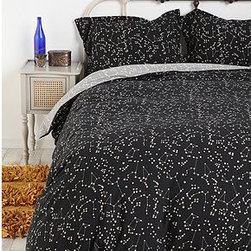 Constellation Duvet Cover - From afar, this duvet cover looks like a simple black cover with a white pattern. But closer inspection reveals a multitude of constellations to learn and trace at night before falling asleep.