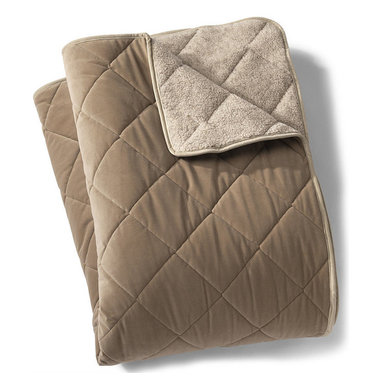 Frontgate - Reversible Quilted Dog Throw - Polyester nylon microvelvet fabric repels hair, dirt, and moisture. Rolls up for easy transport. Diamond quilting and coordinating trim. Machine wash and dry. Our luxurious Reversible Quilted Dog Throw is versatile enough to be used in crates, cars, or on sofas or floors. This throw reverses for a 2-color design. . . . .