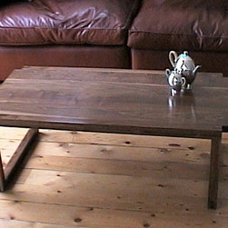 Custom made furniture Loughton, Essex - Solid american black walnut coffee table commissioned by clients. Feature bridal joints at leg junctions. Solid laminated top for rigidity, which floats between the legs.