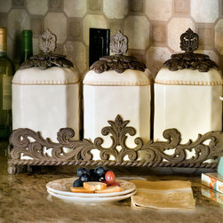 Ceramic Canister Set - New from the GG Collection, this set of ceramic canisters are highlighted with intricate metal touches and nestled in a decorative metal tray. Celebrating the union of style and craftsmanship they make an elegant addition to kitchen or bathroom countertops.