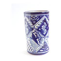 Paloma Wine Bottle Holder - Keep your wine chilled to perfection in this hand-crafted ceramic piece, or use it for flowers, utensils, whatever. Imported from Mexico, it features a traditional motif to add fiesta flair to your favorite setting.