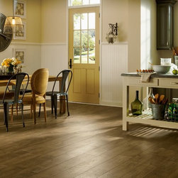Armstrong Rustics Premium Laminate Flooring - X-Grain Khaki - If comfortable and relaxed define your style, the Rustics Premium laminate collection is perfect for you. These floors offer scraped textures and farmhouse-style wide boards that are in step with current interior trends.