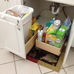 Pull Out Trash Bin and Pull Out Shelf - Convert any existing cabinet into a pull out trash bin, even if your current cabinet is hinged.  Our expert installation teams can convert a hinged door into a pull out trash bin, using your existing door to keep your kitchen's original appearance.