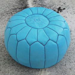 Moroccan Leather Poufs, Blue by Fez Art - This pouf doesn't disappoint. I use these in nurseries, playrooms, living rooms and bedrooms. Nestled next to a chair or in front of a bookcase, they are an awesome way to add a splash of color.