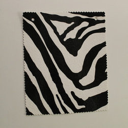 Upholstery Faux Leather - This high quality, faux leather zebra skin is a great fashion choice for any project. With its vibrant white and black stripes arrayed in a beautiful pattern, you can be sure that its soothing imagery will relax and remind you of the peaceful African wilds.