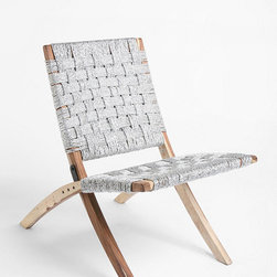 Silver Woven Chair - Woven Silver Folding Chair made of eco-friendly materials. Made from sheesham wood and recycled plastic webbing, this chic metallic chair takes up little space on any outdoor area and folds up for quick storage. Dry weather use only.
