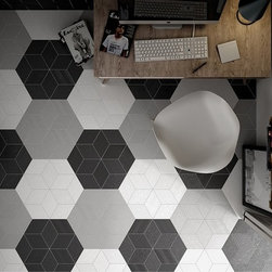 Rhombus Tile - Rhombus 6x10 is a porcelain tile that has different variations. The color shape is the same for all, but there are four different textures and patterns. One has a wavy, lace design on it. One has a grey floral design. One has a zigzag pattern, and one has words pressed on it. The designs translate to the texture. You can feel the lace, the floral pattern, the zigzag formation, and the words on the tile. The colors we carry are light grey, dark grey and white.