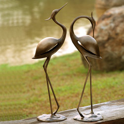 Stylized Garden Heron Pair - Instantly infuse graceful visual serenity into your garden with our magnificent set of stunning heron sculptures. Authentically detailed and life-like in design, these slender herons rise to well over two feet tall and are constructed from weather resistant aluminum. Place our lovely herons lakeside, dockside or in your seaside cottage or home garden.