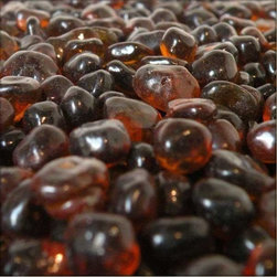 American Fireglass Amber Eco Fire Glass-10 lbs - The amber eco friendly fire glass is produced of melted and color dyed post industrial glass. Made of the same ingredients as American Fireglass traditional fire glass eco glass does not melt degrade or emit toxic fumes and lasts for virtually a lifetime. Able to withstand temperatures of up to 1300 degrees eco fire glass will allow you to go green in a variety of brilliant colors without the worry of melting or sooting that can occur with other recycled glass products.