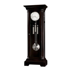 "Howard Miller - Howard Miller - Seville Floor Clock - Think tall, dark, and extraordinarily handsome with this Neoclassic floor clock defined by decadent aged espresso and nickel finish, an exemplary piece to accentuate your home's d̩cor. This neoclassic inspired Floor Clock with Brushed Nickel Accents combines classical, traditional and modern design themes to create a truly elegant contemporary timepiece. This magnificent 83"" tall clock displays a rich Espresso finish with contrasting brushed nickel accents. * This classically inspired floor clock makes a grand addition to our Furniture Trend Designs. . The simple, yet elegant, flat top pediment of this floor clock is reminiscent of classic Greek and Roman architecture. . The door is flanked by twin canted columns with turned top and bottom caps. . The crisp, white dial is framed by a brushed-nickel bezel and features applied, brushed-nickel Arabic numerals with a black screened minute track and nickel hour and minute hands. . The brushed-nickel grid pendulum and nickel finished weight shells complement the bezel. . Clean lines and a simple cutout on the base complete the composition. . All glass panels on the front and sides are beveled. In addition, the upper side glass panels are removable, allowing easy access to the movement. . Designed by Chris Bergelin. . Cable-driven, triple chime Kieninger movement offers automatic nighttime chime shut-off option. . Black Coffee finish on select hardwoods and veneers. . Adjustable levelers under each corner provide stability on uneven and carpeted floors. . You will receive a free heirloom plate, engraved with name and date, by returning the enclosed request card to Howard Miller. . Locking door for added security. . Automatic nighttime chime shut-off option.. Manufacturer's 2 Year Warranty. 83 in. (211 cm) H x 31 in. (79 cm) W x 17 1/2 in. (44 cm) D"