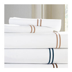 """Frontgate - Grande Hotel Set of Two Pillowcases - 100% Italian-spun Egyptian Cotton Percale. Generously sized to accommodate pillow-top mattresses up to 17"""" deep. Styled after sheets that grace the beds of some of the finest hotels in the world. Machine wash warm on gentle cycle using non-chlorine bleach as needed; wash dark colors separately. Tumble dry on low setting until slightly damp. If you want to recreate the sleep experience of a 5-star hotel, start with the SFERRA Grande Hotel Bedding Collection. Crisp white or ivory linens are framed in tailored, double rows of satin stitching. Woven to a 200 thread-count by master Italian weavers to last through wash after wash.  .  .  .  .  . For best results, pressing is recommended . Fitted sheet in plain white or ivory. Made in Italy by SFERRA. Part of the SFERRA Grande Hotel Bedding Collection."""