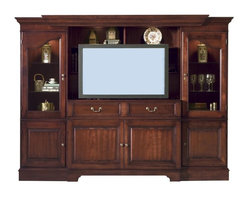 Hekman Furniture - Entertainment-Ret Lift Center in Orchard Cherry Finish - Includes console, left and right pier. Two drawers. Two doors. Two doors and three shelves on both sides. Adjustable levelers provide stability on uneven and carpeted floors. Remote controlled lift mechanism. Accommodates flat panel monitors upto: 50 in. W x 5 in. D x 29.5 in. H. Weight capacity: 170 lbs.. Pier with one door and three adjustable shelves. Two media storage pull-out trays. Optional wood and fabric speaker panel. Infrared repeater device allows remote control of electronic devices behind closed doors. Strategically located cut outs provide neat and orderly routing of cords and connections. Warranty: One year. Made from select hardwoods and veneers. Console: 52 in. W x 22 in. D x 40 in. H. Left and right pier: 23 in. W x 20 in. D x 40 in. H