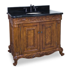 "Hardware Resources - 39"" Wide Solid Wood Vanity  VAN012-T - This 39"" wide solid wood vanity features hand-carved botanical and rope details and framed with reed-style columns. The burled veneer on the cabinet doors lends a rich subtlety to this vanity. This vanity features a patented inner drawer fitted around the plumbing, equipped with ball bearing slides, and additional cabinet space for storage.  This vanity has a 2.5CM black granite top preassembled with an H8809WH (15"" x 12"") bowl, cut for 8"" faucet spread, and corresponding 2CM x 4"" tall backsplash.  Overall Measurements: 39-11/16"" x 22-3/4"" x 33-11/16"" (measurements taken from the widest point) Finish: Golden Pecan Material: Wood Style: Traditional Coordinating Mirror(s): MIR012 Bowl: H8809WH"