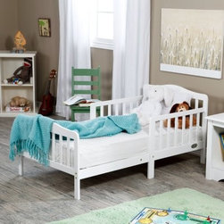 The Orbelle Contemporary Solid Wood Toddler Bed - White - When your baby isn't quite a baby anymore it's time for the Orbelle Contemporary Solid Wood Toddler Bed - White. Nothing compares to solid wood construction and quality so rest assured this bed will last. It even includes side safety rails so your little one won't fall out of bed in the night. In addition the perfect height of 26.5 inches ensures easy in and out and more peace of mind for you. All necessary tools are included for easy assembly. Accommodates a standard crib mattress not included. Make the transition smooth and beautiful with the Orbelle Toddler Bed.About Orbelle TradeBegun in Brooklyn NY in 1991 Orbelle has grown into a leading baby and teen furniture business still family owned and operated. Fast shipping and quality furniture with exclusive designs and colors keep Orbelle at the forefront of baby and kids lines of furniture.