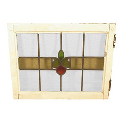 Antiques - Antique English Lead Glazed Stained Glass Window - This is a beautiful antique English lead glazed stained glass window. It has a traditional wooden frame and it features a beautiful *astragal lead glazed textured stained glass window with a distinguished design.  It may show minor age appropriate signs of wear including wood imperfectionsbut as shown it is overall in very good cosmetic and structural condition.What is astragal (wood or lead) glazing?  As it pertains to later period furniture, it is a method of securing glass to the straight, semi-circular, or shaped moldings found on glass doors and windows of furniture. On newer reproduction furniture, the astragal molding may set atop the glass to give the appearance of glazing where on older English furniture, it is not uncommon for each piece of glass to be cut to shape and glazed into the molding.Other Dimensions (In inches)Glass 15.25H x 20.25WFrame 1.75W