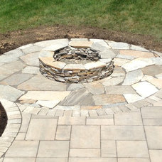 Rustic Patio by Stillman Landscape