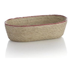 Sarinana Small Oval Basket with Coral Rim - A community of Mexican artisans weaves these small ovals in tight, sturdy palm plaits, contrasting the textured natural neutrals with a coral red rim. Stylish storage solution is a countertop catchall for soaps, washcloths and more, adding a warm, organic grace note to the bathroom...or any room.