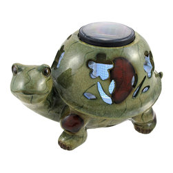 Zeckos - Outdoor Turtle Solar Lantern Garden Accent - Add an adorable, glowing accent to your garden or flower bed with this turtle shaped solar lantern. Made of cold cast resin, it measures 7 inches tall, 11 inches long, and 7 1/2 inches wide. Flower shaped cutouts in the turtle shell allow light to shine through when it starts to get dark in the evening, and the 4 inch diameter solar panel charges the light all day. There is an on/off button under the edge of the solar panel so you can control the lighting. It is sure to be admired, and makes a great gift for a friend.