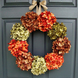 Fall Hydrangea Door Wreath from HomeHearthGarden - Nothing matches the beauty for a hydrangea wreath. Truly an elegant combination of colors, this wreath design captures a mélange of hydrangea colors and endless summer deep tones. A dramatic collection of large artificial pom-pom style hydrangea flowers. A wreath that brings life to your front door or over the hearth, welcoming your guests to your front door.