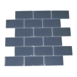 """Spa Glass - Blue 2X4 Subway Glass Tile, Blue, 2x4, Carton - CARTON of Blue 2X4 subway glass tile consisting of 20 square feet or sheets. This tile is manufactured in a thinner 1/8 inch thick format and is a high quality """"POOL RATED"""" glass subway tile that is perfect for a kitchen backsplash, bathroom tile, shower tile or pool tile. Because the tiles are thinner and come mesh mounted in a staggered interlocking brick pattern, installation is much easier and much less expensive. The thinner profile eliminates the need for tear outs or large demolitions. You can tile over existing materials and eliminate installation cost ( think DIY).These are a very high grade glass subway tile kilned at 800 Celsius for maximum durability and come with a baked polypropylene backing which reflects the color back thru a very clear glass.  The tiles come in a 12X12 inch sheet consisting of 18 tiles 2X4 inches in size.  They come in boxes of 20 square feet or 20 sheets. There is also a SAMPLE option so you can confirm the color is perfect for your space. The Price listed is for a single CARTON OF 20 SQUARE FEET."""