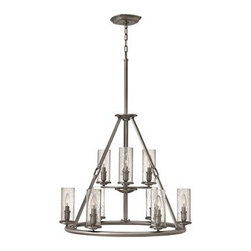 Hinkley Lighting - Hinkley Dakota Polished Antique Nickel Nine-Light 29 Wide Chandelier - The Dakota collection rounds up the best in Western style with a rustic chic design. Cast metal faux leather straps and buckle combine with clear seedy hurricane shades perched on cast cups for luxe lodge charm.Under four generations of family leadership Hinkley Lighting has transformed from a small outdoor lantern company to a global brand intent on bringing you the best in style quality and value. LIFE AGLOW: That's their mantra and they take it seriously. By welcoming their products into your home they become part of your family's everyday life illuminating small moments and big occasions. They understand your home is so much more than a physical place. It's an emotional space designed by you so they are committed to keeping your 'Life Aglow' with stylish state-of-the-art lighting. Their products are the ultimate combination of style and substance. They are constantly developing new technologies to make their fixtures even more energy efficient. Hinkley recently upgraded their LED to cutting-edge high lumen output integrated solutions and they give you hundreds of energy-efficient styles to choose from. Even their Cleveland-based world headquarters employs high energy saving standards with low VOC materials and a variety of eco-smart applications into the design to make an earth-friendly work environment for their Hinkley family. Hand crafted fixtures luxe finishes artistic details and quality materials go into the design of every product they make. They embrace the philosophy that you can merge together the lighting furniture art and accessories you love into a beautiful environment that defines your own personal style.