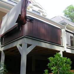 Great Hot Tub Deck Design - A sloping elevation makes for an elevated hot tub installation. Great planning and design allows for clients to make the most out of a small custom deck . Coverlifter provides additional privacy from neighboors. Photo courtesy of Atlantic Spas and Billiards