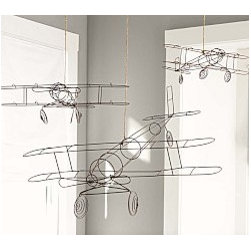 wire airplanes - Add a touch of whimsy to your child's room with playful wireframe airplanes.